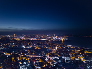 View of the night city in winter from a bird's eye view