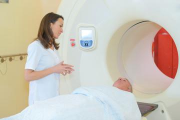 Nurse talking to man entering scanner