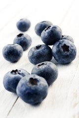 blueberries on white wood