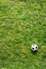 Flatlay, soccer ball on turf