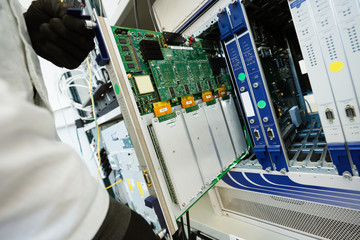 Picture of technician repairing cmts networking cards