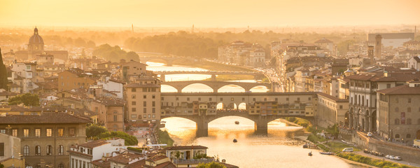 Wall Mural - Panoramic aerial view of Florence at sunset  with the Ponte Vecchio and the Arno river, Tuscany, Italy