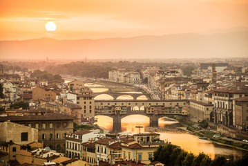 Fototapete - Aerial view of Florence at sunset  with the Ponte Vecchio and the Arno river, Tuscany, Italy