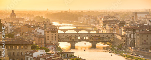 Wall mural Panoramic aerial view of Florence at sunset  with the Ponte Vecchio and the Arno river, Tuscany, Italy