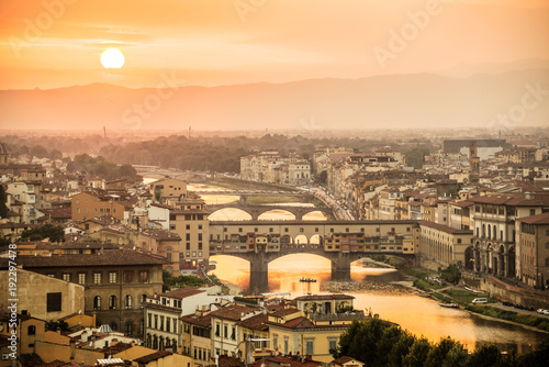 Wall mural Aerial view of Florence at sunset  with the Ponte Vecchio and the Arno river, Tuscany, Italy