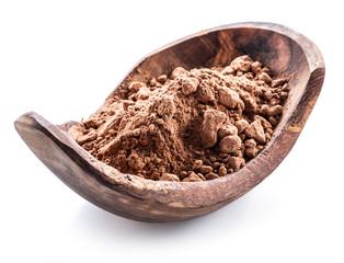 Cocоa powder or carob powder in wooden bowl on white background.