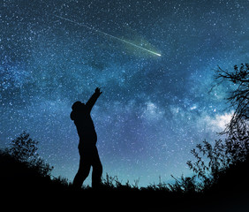 man watching the stars in night sky