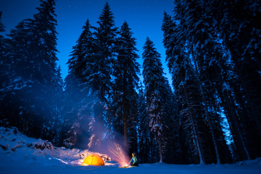 winter camping with fire at night