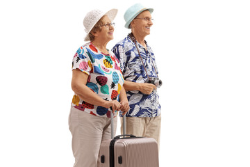 Elderly tourists with a suitcase