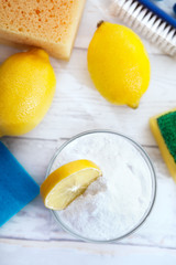 "Natural cleaners, lemon and baking soda"" on old wooden backgroun"