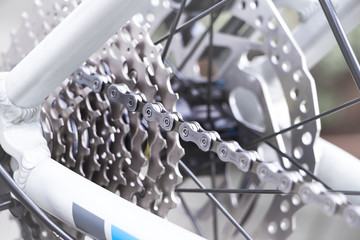 Bicycle gear and disk brake detail, close up shot of new and clean silver mountainbike metal chain rings