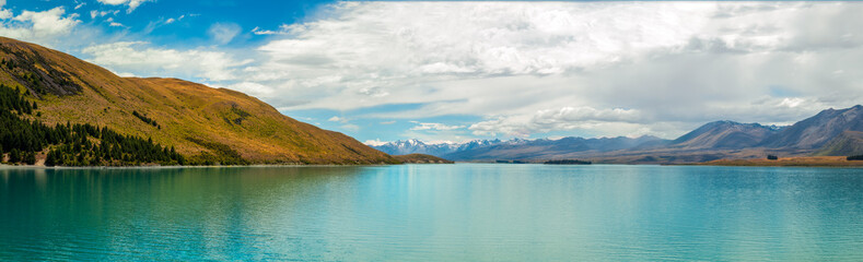 Panorama of Lake Tekapo with turquoise waters in New Zealand