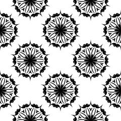 Black floral seamless design on white background