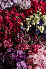 Fresh flowers at a florist shop, Different flowers: lilac, carnations,roses, orchids, tulips in an endless arrangement