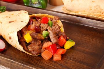 Beef burrito wrap sandwich close up