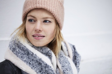 Beautiful young woman in winter clothing, looking away