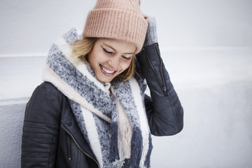 Beautiful young woman in woolly and jacket, smiling