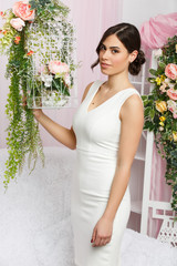 Image of beautiful woman next to cage with flowers