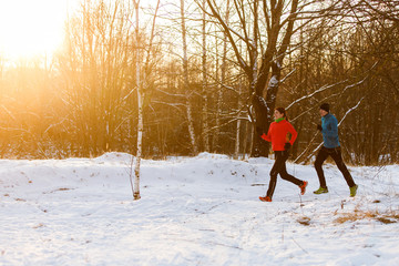 Photo of sports woman and man on morning run in winter