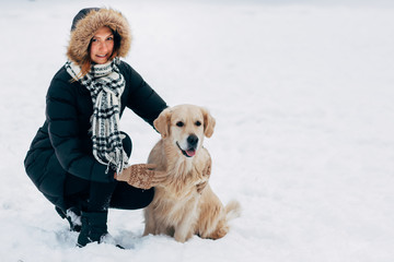 Picture of smiling woman with dog in winter park