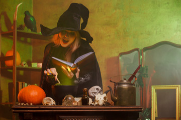 Image of witch with spell book in dark room
