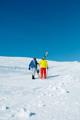 Image of sports couple falling with snowboard