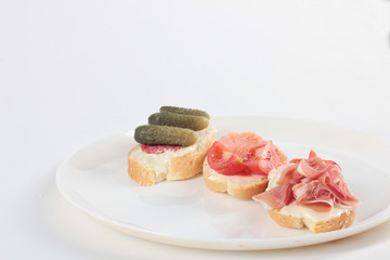 Three tapas on a plate