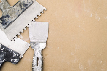 Old spatula for wall repair.