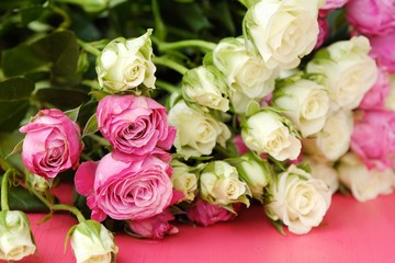 Beautiful bouquet of white and pink roses on pink background