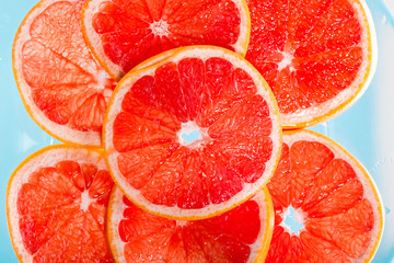Grapefruit slice in the water. Top view.