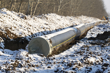 New pipeline of propylene DN 350 near the trench in winter
