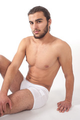Studio portrait of young sporty male model in underwear