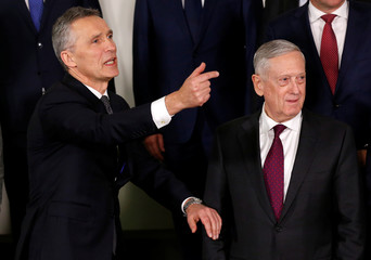 NATO Secretary-General Stoltenberg and U.S. Secretary of Defence Mattis pose for a family photo in Brussels