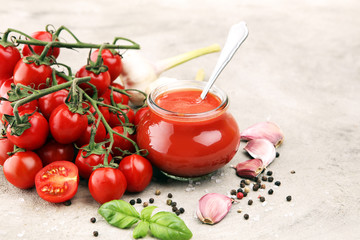 Fresh cherry tomato sauce on rustic background with cherry tomatoes.