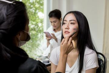 Beautiful young asian woman makeup face.