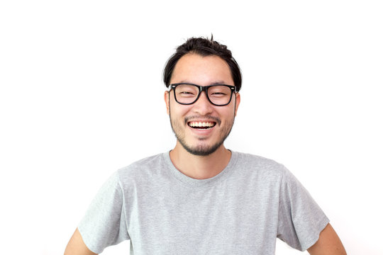 Closeup portrait of happy asian man face, isolated on white background with copy space.