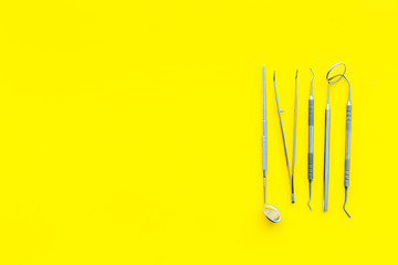 Dentist tools. Teethcare, dental health concept. Yellow background top view copy space