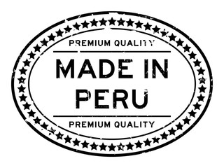 Grunge black premium quality made in Peru oval rubber seal stamp on white background
