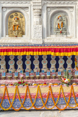 architectural detail with Buddha statues at the Mahabodhi Temple, Bodhgaya, Bihar, India