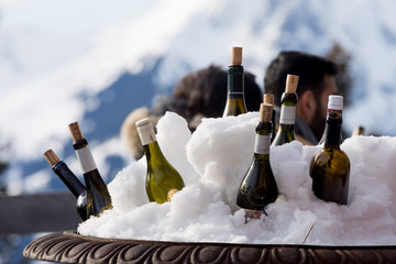Wine Bottles in the Snow
