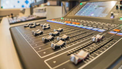 Selective focus buttons equipment for sound mixer control with blurry background., in live studio for broadcasting.