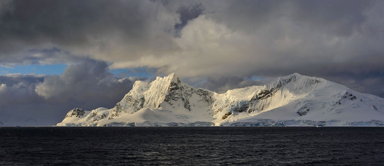 Antarctic landscape with mountains view from sea panoramic