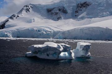 Antarctic landscape with iceberg