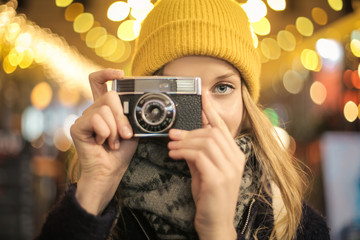 Cute girl making photos with a retro camera