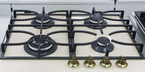 A fragment of the cooktop of the gas stove.