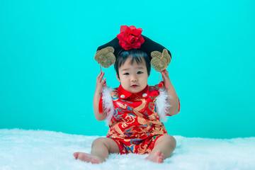 Asian cute baby wear cheongsam dress,Happy chinese new year concept,Thailand baby girl