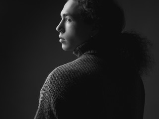 profile of curly  man. low key