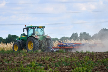 Tractor harrowing the field