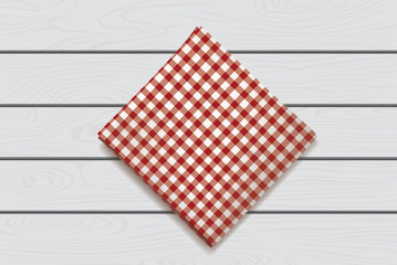 Red napkin on a wooden background. Plaid gingham tablecloth for cafe and restaurant design