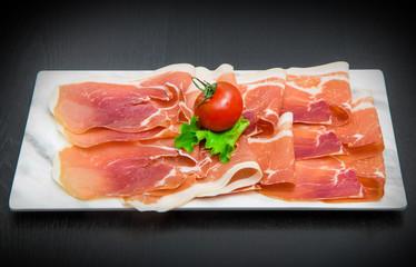 marble dish with raw ham